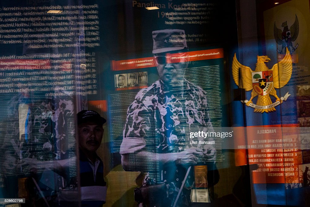 Soeharto photograph is seen as a visitor walks at Soeharto museum as on May 06, 2016 in Yogyakarta, Indonesia. Survivors of Indonesia's anti-communist massacres in 1965 called for investigations on the country's purges, in which hundreds of thousands of people are believed to have been killed by the Indonesian military when the Cold War was escalating in Southeast Asia. Based on human rights groups, half a million people died in 1965 during a massacre carried out by the military and religious groups after an attempted coup by suspected communists, where an officer-led group kidnapped and executed six generals on the night of Septemeber 30, 1965. Known as one of the worst mass atrocities of the 20th century, many among the dead had no connection to Communism, and hundreds of thousands had been held in dentention centers for years during the period.