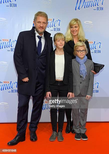 Soenke Wortmann Cecilia Kunz and her children attend the 'Das Wunder von Bern' musical premiere on November 23 2014 in Hamburg Germany