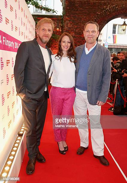 Soenke Wortmann Lavinia Wilson and Guest attend the NRW Filmparty at Wolkenburg on June 17 2014 in Cologne Germany