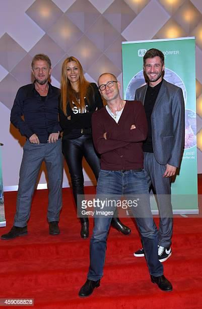 Soenke Wortmann Yasmina Filali Peter Lohmeyer and Jochen Schropp attend photocall of SOS Kinderdorf at 'Theater an der Elbe' on November 15 2014 in...
