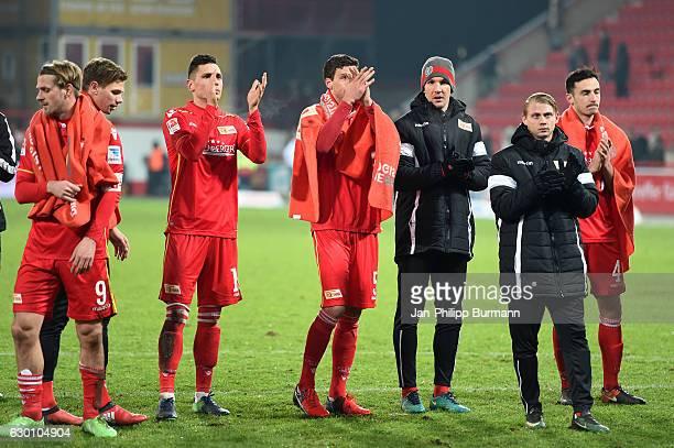 Soeren Brandy Daniel Mesenhoeler Damir Kreilach Benjamin Kessel Michael Gspurning Simon Hedlund and Roberto Puncec of 1 FC Union Berlin after the...