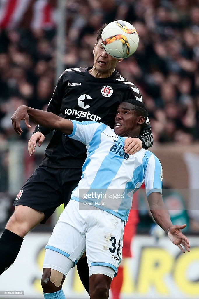 Soeren Gonther (L) of Hamburg and Florent Romuald Lacazette (R) of Muenchen compete for the ball during the Second Bundesliga match between FC St. Pauli and 1860 Muenchen at Millerntor Stadium on April 29, 2016 in Hamburg, Germany.