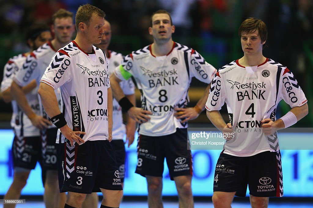 Soeren Soendergaard, Mads Christiansen and Patrick Larsen of Holstebro look dejected after the EHF Cup Semi Final match between Tvis Holstebro and HBC Nantes at Palais des Sports de Beaulieu on May 18, 2013 in Nantes, France. The match between HBC Nantes and Tvis Holstebro ended 26-20.