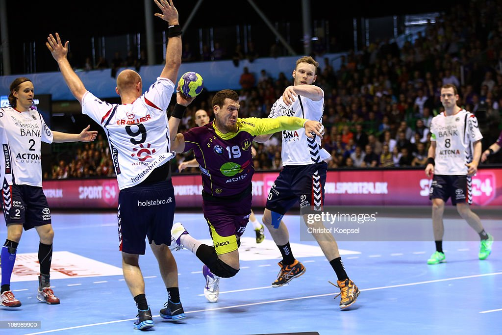 Soeren Soerensen of Holstebro (L) and Klaus Thomsen of Holstebro (R) defend against Borja-Vidal Fernandez of Nantes (C) during the EHF Cup Semi Final match between Tvis Holstebro and HBC Nantes at Palais des Sports de Beaulieu on May 18, 2013 in Nantes, France.