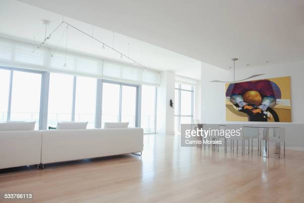 Sofa and dining table in open living space of apartment