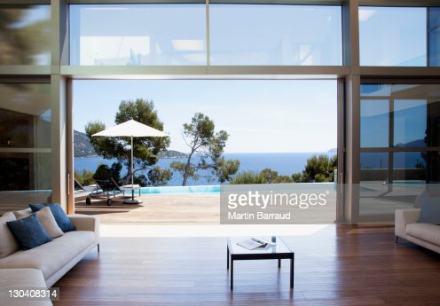 sofa and sliding doors in open modern house : Stock Photo