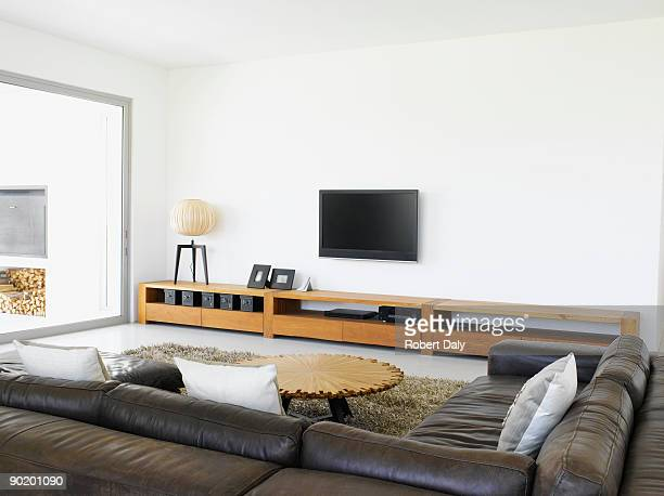 Sofa and television in living room of modern home