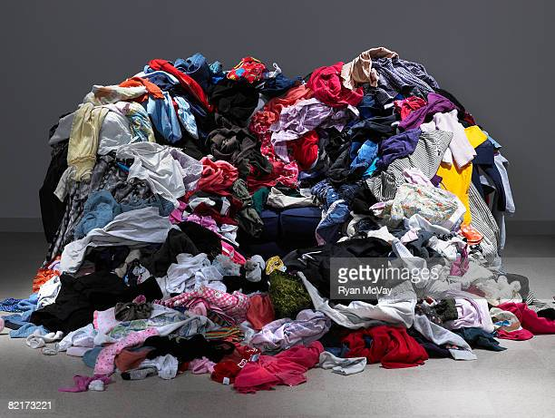 Sofa buried under piles of clothes