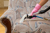 Sofa chemical cleaning with professionally extraction method. Upholstered furniture. Early spring cleaning or regular clean up.