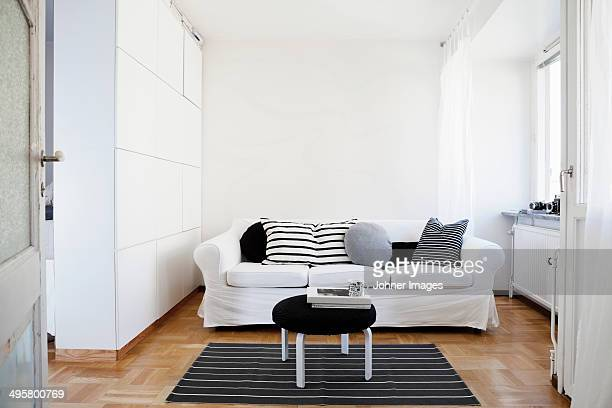 A sofa in a white living room