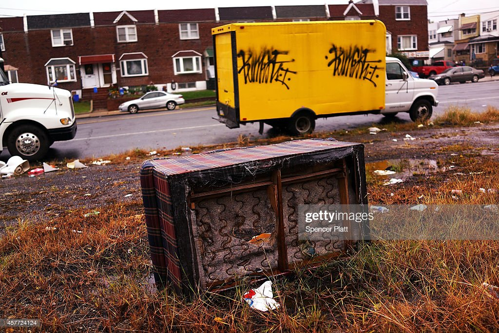 A sofa sits abandoned in a lot in a high poverty area on October 22 2014 in Philadelphia Pennsylvania One of the nation's largest and most historic...