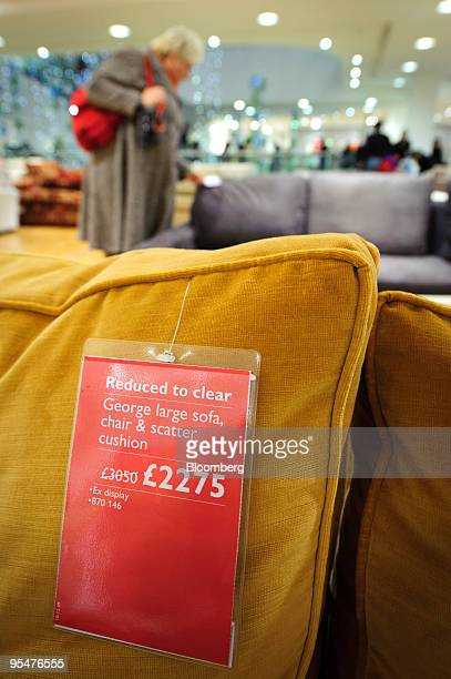 A sofa sits on display during the sales at the John Lewis store on Oxford Street in London UK on Monday Dec 28 2009 More UK consumers stepped out to...