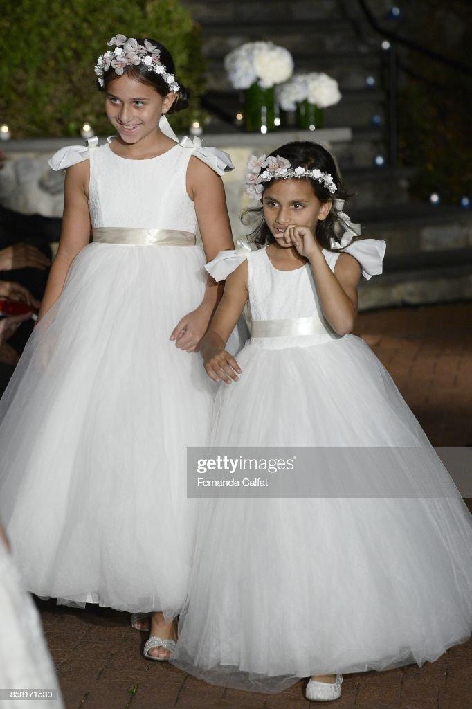 Sofia And Isabella Sarraf walk at Po de Arroz Runway at New York Fashion Week Bridal October 2017 at Hendrick's Tavern on October 5, 2017 in Roslyn, New York.