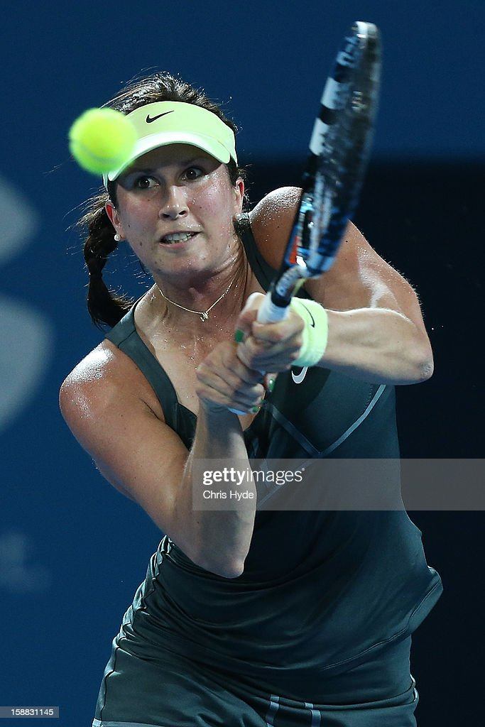 <a gi-track='captionPersonalityLinkClicked' href=/galleries/search?phrase=Sofia+Arvidsson&family=editorial&specificpeople=585512 ng-click='$event.stopPropagation()'>Sofia Arvidsson</a> of Sweden plays a backhand in her match against Stosur of Australia during day two of the Brisbane International at Pat Rafter Arena on December 31, 2012 in Brisbane, Australia.