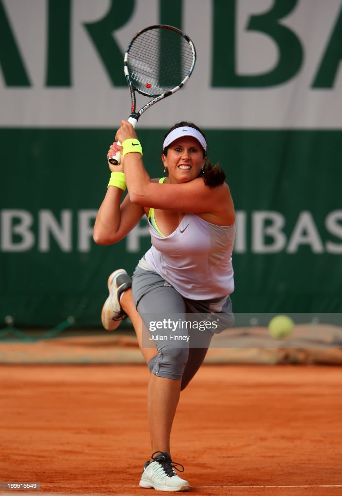 <a gi-track='captionPersonalityLinkClicked' href=/galleries/search?phrase=Sofia+Arvidsson&family=editorial&specificpeople=585512 ng-click='$event.stopPropagation()'>Sofia Arvidsson</a> of Sweden plays a backhand in her Women's Singles match against Sabine Lisicki of Germany during day one of the French Open at Roland Garros on May 26, 2013 in Paris, France.