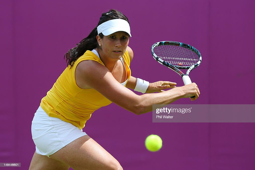 <a gi-track='captionPersonalityLinkClicked' href=/galleries/search?phrase=Sofia+Arvidsson&family=editorial&specificpeople=585512 ng-click='$event.stopPropagation()'>Sofia Arvidsson</a> of Sweden plays against Vera Zvonareva of Russia during her Women's Singles Tennis match on Day 1 of the London 2012 Olympic Games at the All England Lawn Tennis and Croquet Club in Wimbledon on July 28, 2012 in London, England.