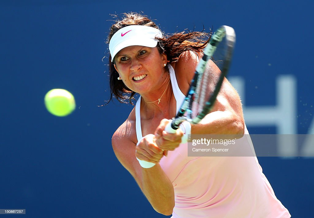 <a gi-track='captionPersonalityLinkClicked' href=/galleries/search?phrase=Sofia+Arvidsson&family=editorial&specificpeople=585512 ng-click='$event.stopPropagation()'>Sofia Arvidsson</a> of Sweden returns a shot against Kimiko Date-Krumm of Japan during their women's singles first round match on Day Two of the 2012 US Open at USTA Billie Jean King National Tennis Center on August 28, 2012 in the Flushing neigborhood of the Queens borough of New York City.