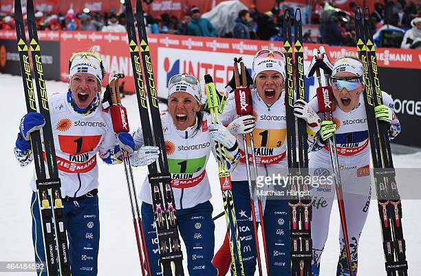 Sofia Bleckur Charlotte Kalla Maria Rydqvist and Stina Nilsson of Sweden celebrate winning the silver medal in the Women's 4 x 5km CrossCountry Relay...
