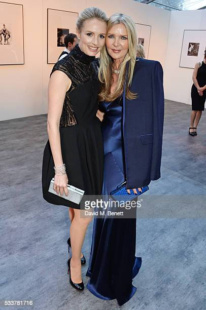 Sofia Blunt and Amanda Wakeley attend British Vogue's Centenary gala dinner at Kensington Gardens on May 23 2016 in London England