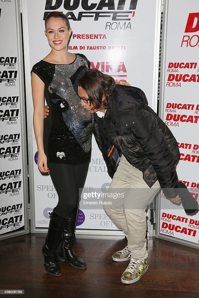 <a gi-track='captionPersonalityLinkClicked' href=/galleries/search?phrase=Sofia+Bruscoli&family=editorial&specificpeople=2126145 ng-click='$event.stopPropagation()'>Sofia Bruscoli</a> and Marcelo Fuentes attend the 'Indovina Chi Viene A Natale' party at Ducati Caffe on December 19, 2013 in Rome, Italy.