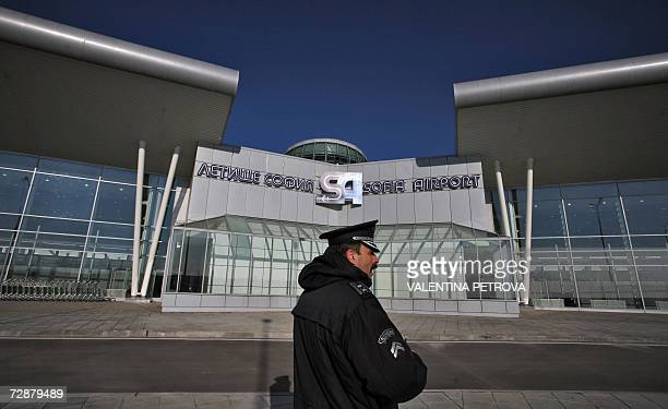 A Bulgarian policeman stands guard in front of the new passenger terminal officially opened at the Sofia Airport 27 December 2006 in Bulgaria The new...