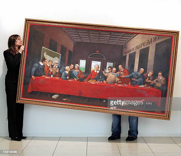 Gallery staff carry a Bulgarian painting inspired by Leonardo Da Vinci's masterpiece 'The Last Supper' to hang it on the wall of a gallery in Sofia...