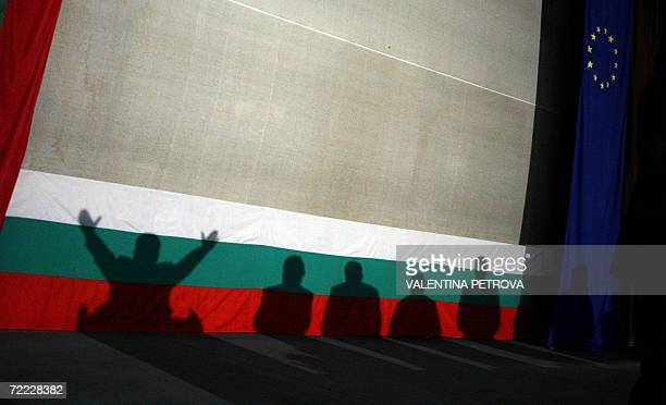 Shadows cast on Bulgarian and the EU flag of the ultra nationalist presidential candidate Volen Siderov and his partygoers during the final meeting...