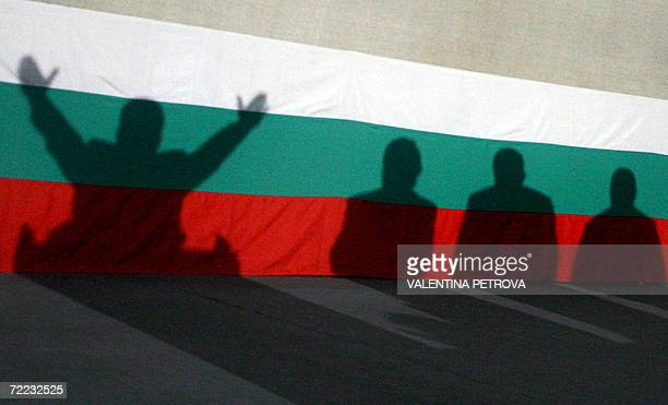 Shadows cast on Bulgarian flag of the ultra nationalist presidential candidate Volen Siderov and his partygoers during the final meeting of his...