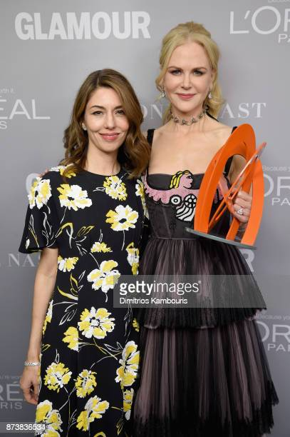 Sofia Coppola and Nicole Kidman pose with an award at Glamour's 2017 Women of The Year Awards at Kings Theatre on November 13 2017 in Brooklyn New...