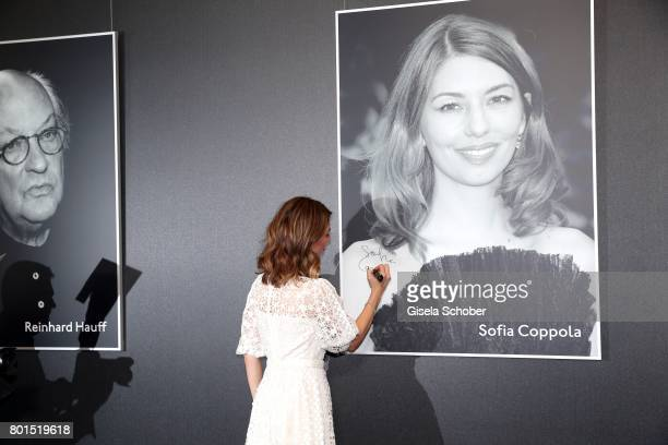 Sofia Coppola signs her photo during the premiere of the movie 'Die Verfuehrten' during the film festival Munich at Gasteig on June 26 2017 in Munich...
