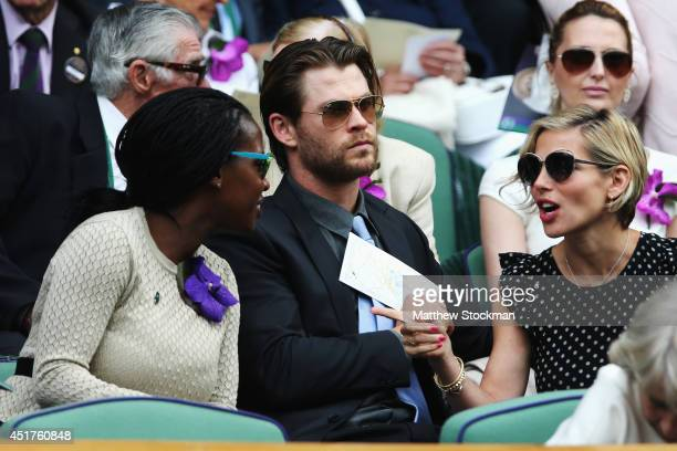 Sofia Davis Chris Hemsworth and Elsa Pataky in the Royal Box on Centre Court before the Gentlemen's Singles Final match between Roger Federer of...