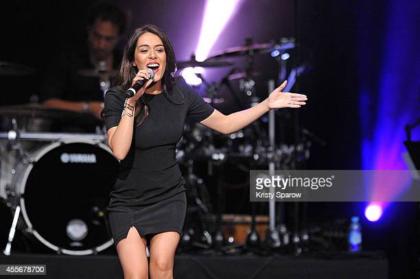 Sofia Essaidi performs onstage during 'Leurs Voix Pour L'Espoir 2014' concert at L'Olympia on September 18 2014 in Paris France