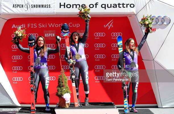 Sofia Goggia of Italy in second place Federica Brignone of Italy in first place Marta Bassino of Italy in third place celebrate after the ladies'...