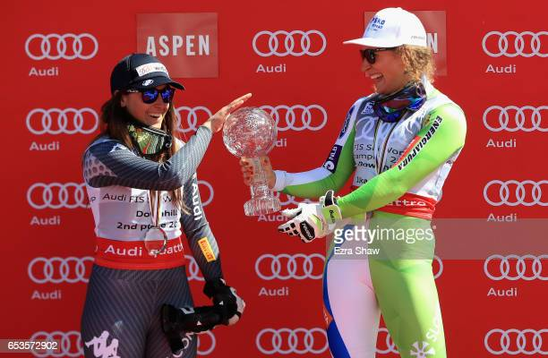 Sofia Goggia of Italy jokingly rubs the globe that Ilka Stuhec of Slovenia won for the overall World Cup Ladies' Downhill title following the 2017...