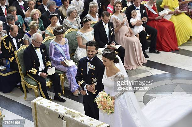 Sofia Hellqvist and Sweden's Prince Carl Philip stand at the alter during their wedding ceremony at the Royal Chapel in Stockholm Palace on June 13...
