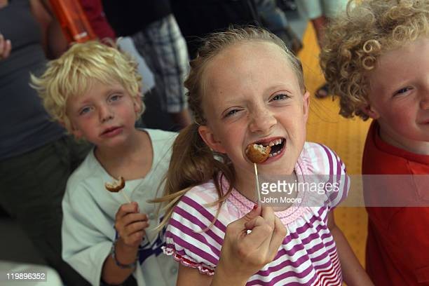 Sofia Hickey eats free Swedish meatballs handed by Ikea to customers and their families awaiting the grand opening of the new Ikea home furnishings...