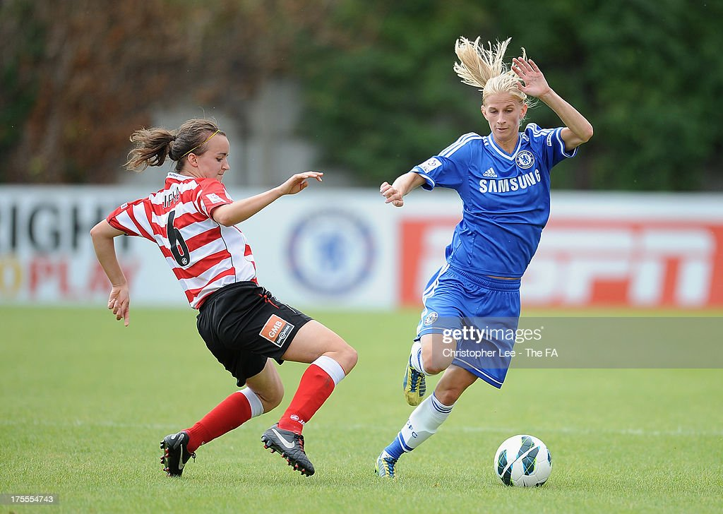 <a gi-track='captionPersonalityLinkClicked' href=/galleries/search?phrase=Sofia+Jakobsson&family=editorial&specificpeople=7097023 ng-click='$event.stopPropagation()'>Sofia Jakobsson</a> of Chelsea avoids the tackle from Kasia Lipka of Doncaster during The FA Womens Super League match between Chelsea Ladies and Doncaster Rovers Belles Ladies at Wheatsheaf Park on August 4, 2013 in Staines, England.