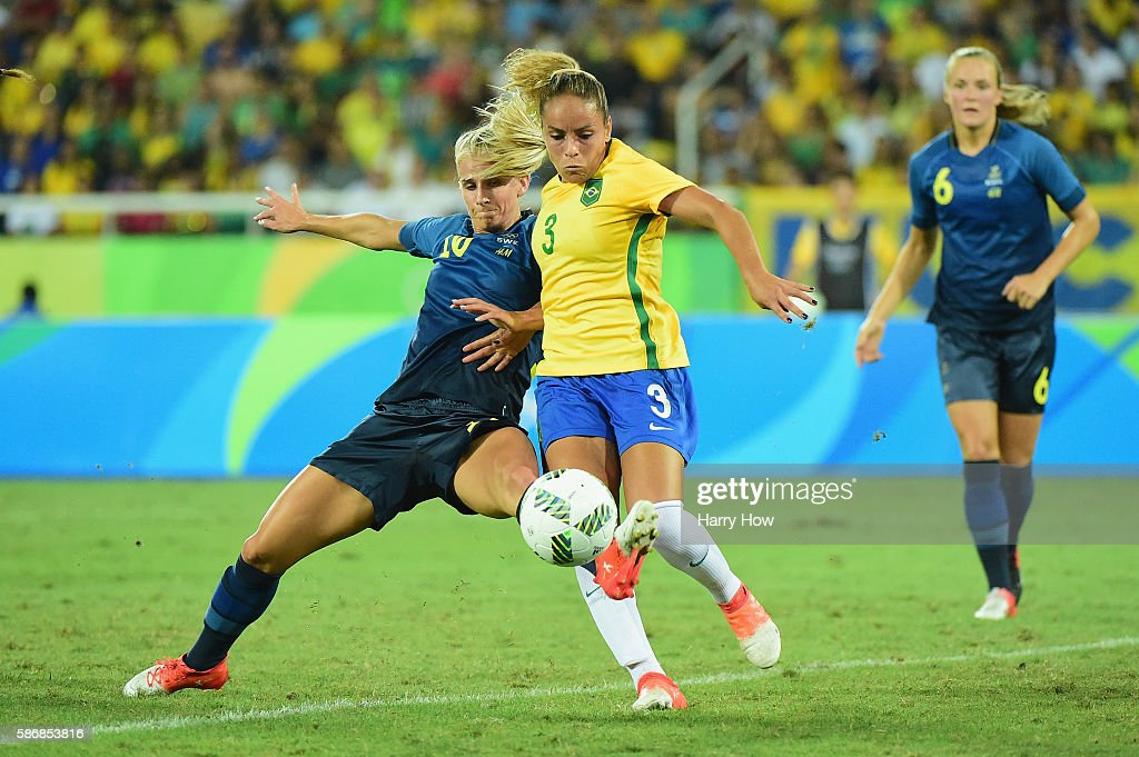 Sofia Jakobsson of Sweden and Monica of Brazil compete for the ball during the Women's Group E first round match between Brazil and Sweden on Day 1...
