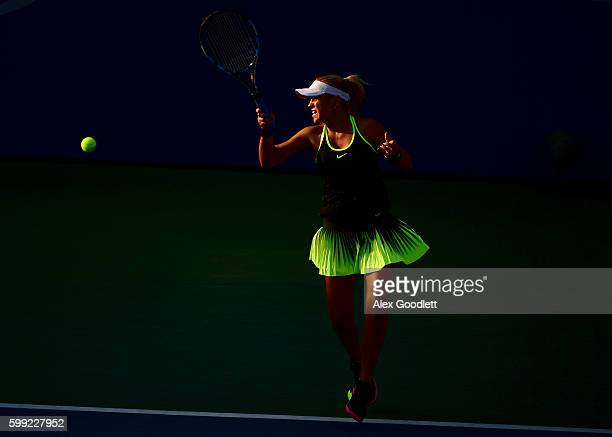 Sofia Kenin of the United States returns a shot to Mai Hontama of Japan during her first round Junior Girl's match on Day Seven of the 2016 US Open...