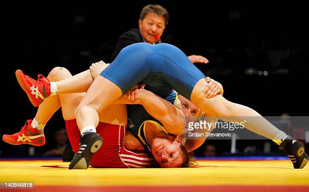 Sofia Mattsson of Sweden fights with Nataliya Synyshyn of Ukraine of Woman's Freestyle 55kg during the European wrestling championship March 08 2012...