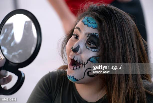 Sofia Romero reacts after getting her face painted during the Denver Botanic Gardens 'Dia de los Muertos' Day of the Dead celebration on November 4...