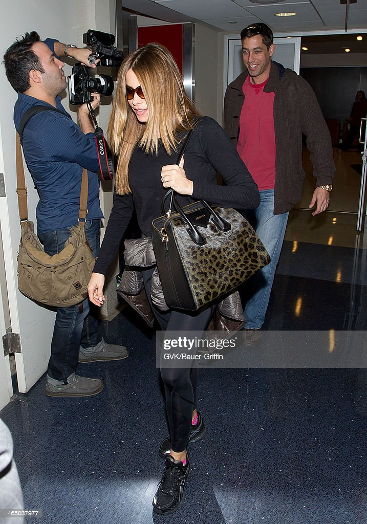 <a gi-track='captionPersonalityLinkClicked' href=/galleries/search?phrase=Sofia+Vergara&family=editorial&specificpeople=214702 ng-click='$event.stopPropagation()'>Sofia Vergara</a> and Nicholas Loeb seen at LAX airport on January 25, 2014 in Los Angeles, California.