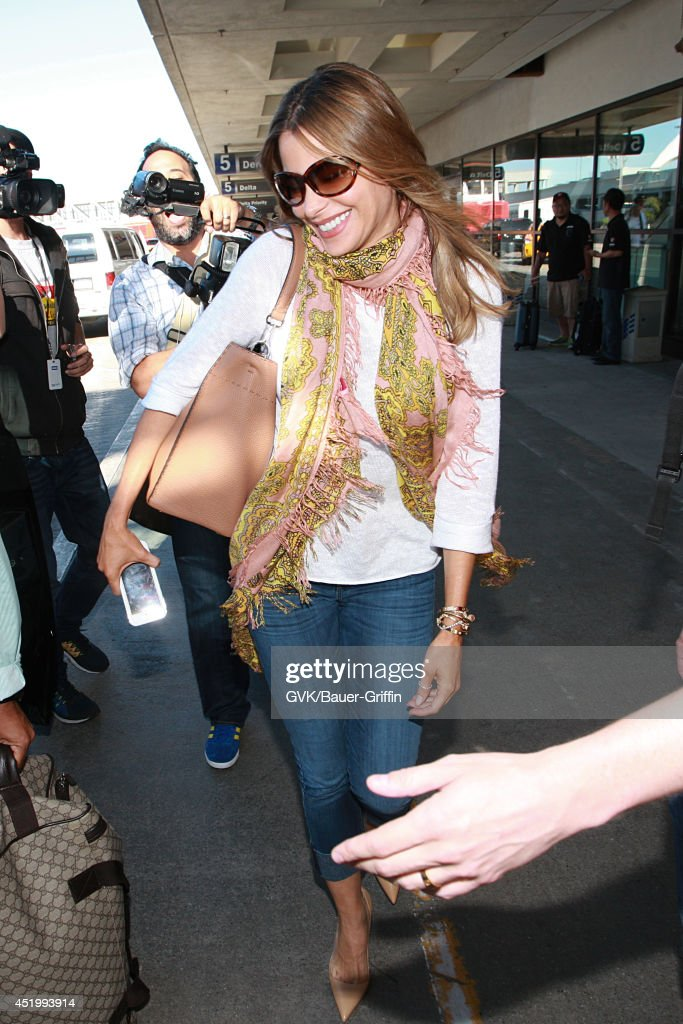 <a gi-track='captionPersonalityLinkClicked' href=/galleries/search?phrase=Sofia+Vergara&family=editorial&specificpeople=214702 ng-click='$event.stopPropagation()'>Sofia Vergara</a> seen at LAX on July 10, 2014 in Los Angeles, California.