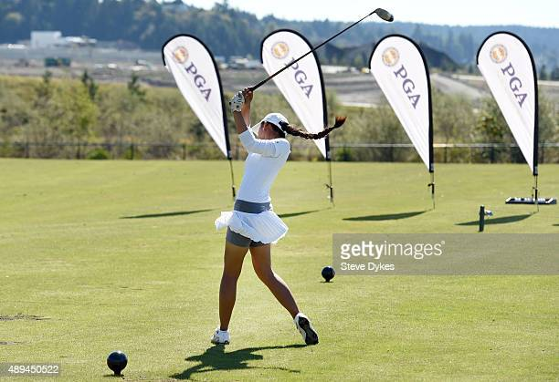 Sofia Young competes in the driving event in the Girls 1415 yr old division during the Drive Chip and Putt regional qualifying at Chambers Bay on...