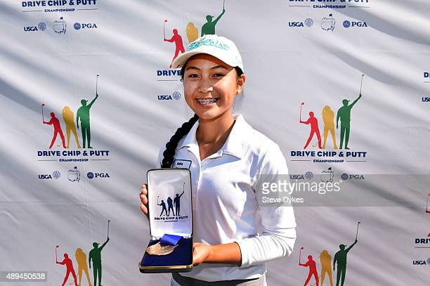 Sofia Young poses with her medal after winning the Chipping competition in the Girls 1415 yr old division during the Drive Chip and Putt regional...