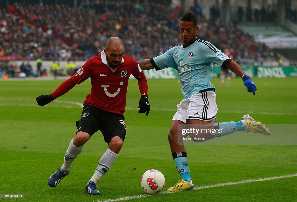 Sofian Chahed (L) of Hannover and Dennis Aogo of Hamburg compete for the ball during the Bundesliga match between Hannover 96 and Hamburger SV at AWD Arena on February 23, 2013 in Hannover, Germany.