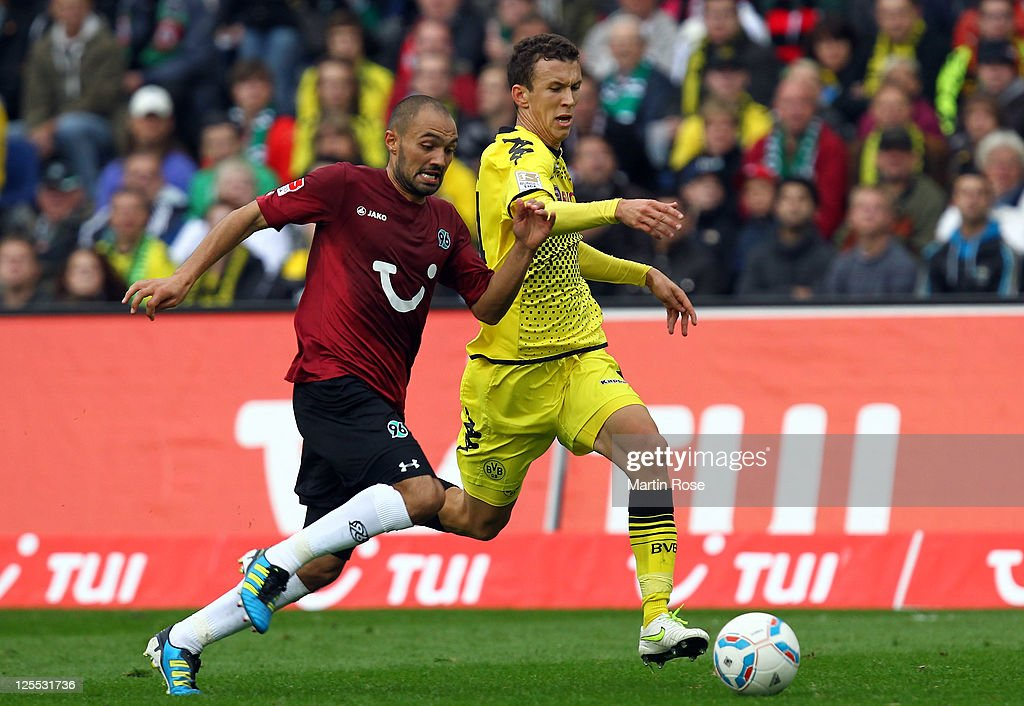 Sofian Chahed of Hannover and Ivan Perisic of Dortmund battle for the ball during the Bundesliga match between Hannover 96 and Borussia Dortmund at...