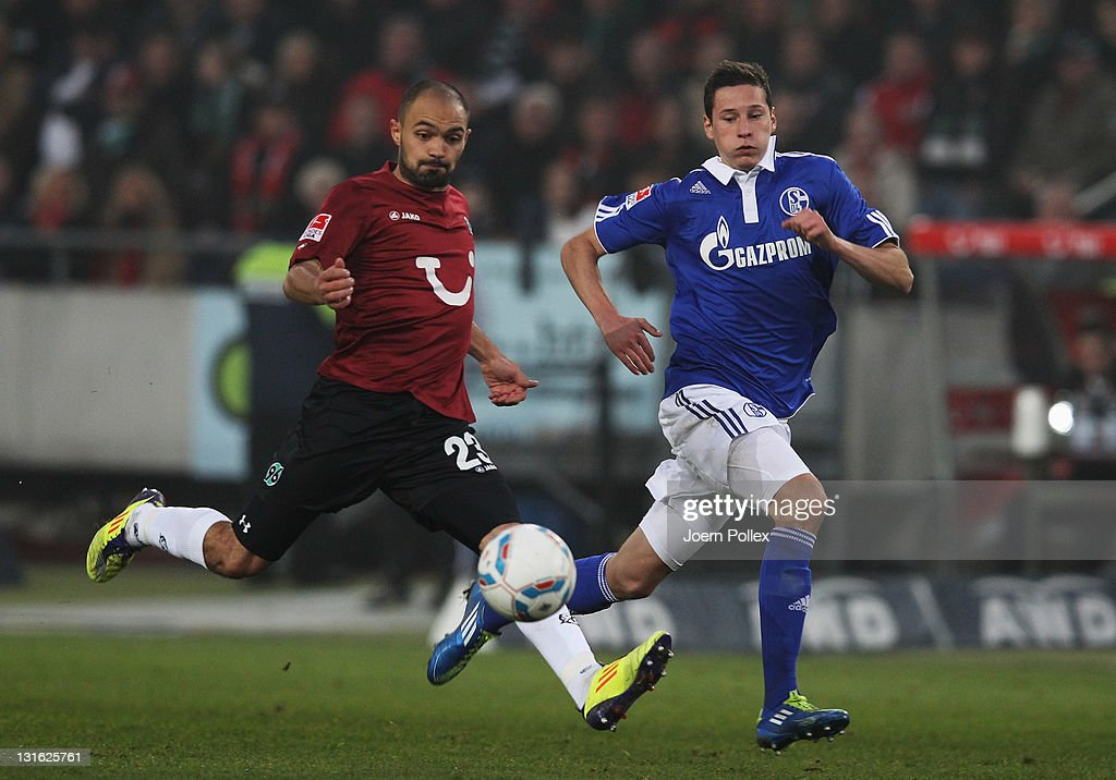 Sofian Chahed of Hannover and Julian Draxler of Schalke battle for the ball during the Bundesliga match between Hannover 96 and FC Schalke 04 at AWD...