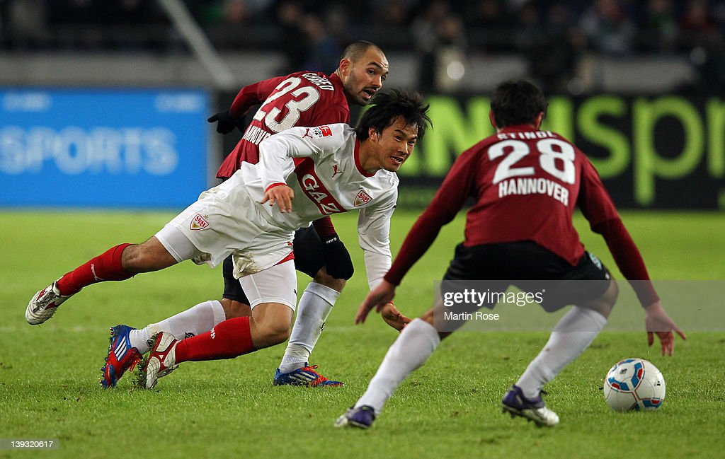 Sofian Chahed of Hannover and Shinji Okazaki of Stuttgart battle for the ball during the Bundesliga match between Hannover 96 and VfB Stuttgart at...