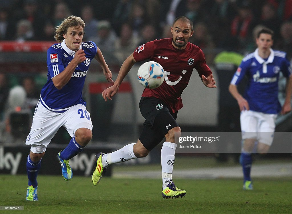 Sofian Chahed of Hannover and Teemu Pukki of Schalke battle for the ball during the Bundesliga match between Hannover 96 and FC Schalke 04 at AWD...